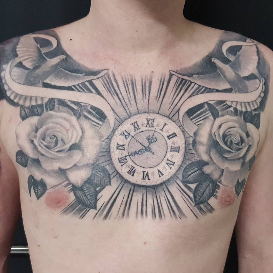 068155543 This wow clock, doves, and roses tattoo can be perfectly placed on your  breast.
